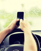 Man using phone while driving the car — Стоковое фото