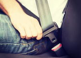 Man fastening seat belt in car — Stock Photo