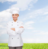 Smiling female chef with crossed arms — Stock Photo