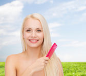 Smiling woman with hair brush — Foto de Stock