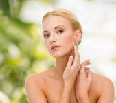 Beautiful woman touching her face skin — Stock Photo
