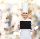 Smiling female chef with black blank paper — Foto de Stock