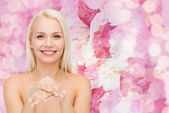 Face and hands of beautiful woman — Stock Photo