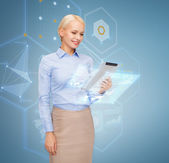 Smiling woman looking at tablet pc computer — Stock Photo