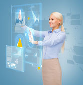Smiling businesswoman working with virtual screen — Stockfoto