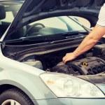 Man opening car bonnet — Stock Photo #48646711