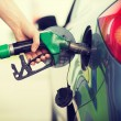 Man pumping gasoline fuel in car at gas station — Stock Photo #48646899