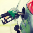 Pumping gasoline fuel in car at gas station — Stock Photo #48646903