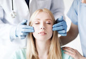Plastic surgeon and nurse with patient — Stock Photo
