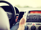 Man using phone while driving the car — Foto de Stock