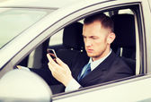 Man using phone while driving the car — Stock Photo