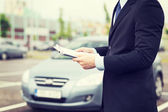 Man with car documents outside — Foto de Stock