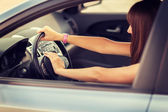 Woman driving a car with hand on horn button — Stock Photo