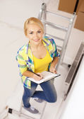 Smiling woman with clipboard — Stock Photo