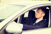 Businessman driving a car — Stock Photo