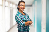 Smiling young woman in eyeglasses at school — Stock Photo