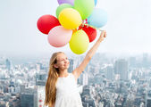 Happy girl with colorful balloons — Stock Photo