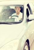 Man placing parking clock on car dashboard — Stock Photo