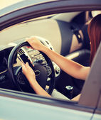 Woman using phone while driving the car — Stock Photo
