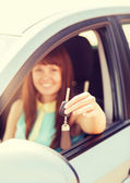 Happy woman holding car key — Stock Photo