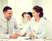 Usiness colleagues talking in office — Stock Photo