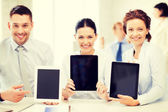 Business team showing tablet pcs in office — Stock Photo