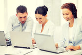 Group of people working with laptops in office — Stock Photo