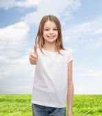 Girl in blank white t-shirt showing thumbs up — Стоковое фото
