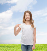 Smiling little girl in blank white t-shirt — Stock Photo