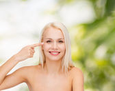 Beautiful woman touching her eye area — Stock Photo