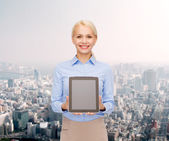 Businesswoman with blank black tablet pc screen — Foto de Stock