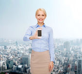 Smiling businesswoman with smartphone blank screen — ストック写真