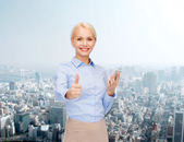 Young smiling businesswoman with smartphone — Foto de Stock
