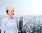 Friendly female helpline operator with headphones — ストック写真
