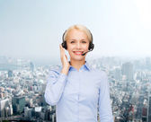 Friendly female helpline operator — Stock Photo