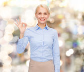 Smiling businesswoman showing ok-sign with hand — Стоковое фото