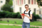 Travelling student with backpack and book — Foto de Stock