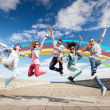 Group of teenagers jumping — Stock Photo #48893191