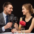 Young couple with glasses of wine at restaurant — Stock Photo #48894055