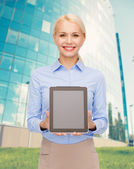 Businesswoman with blank black tablet pc screen — Stock Photo