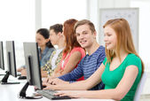 Smiling student with computer studying at school — Stock Photo