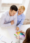 Couple looking at blueprint and color samples — Stock Photo