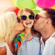 Family with colorful balloons — Stock Photo #48938987
