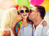 Family with colorful balloons — Foto de Stock