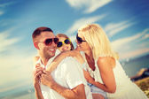 Happy family in sunglasses having fun outdoors — Stock Photo