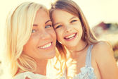 Happy mother and child girl outdoors — Stock Photo