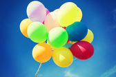 Lots of colorful balloons in the sky — Stock Photo