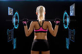 Sporty woman exercising with barbell — Stock Photo