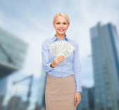Young businesswoman with dollar cash money — Stock Photo