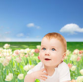 Smiling baby looking up — Stock Photo